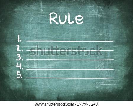 Rule list on blank chalkboard  - stock photo