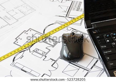Ruler and notebook on a floor plan