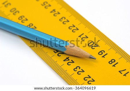 Ruler and pencil closeup, shallow DOF - stock photo