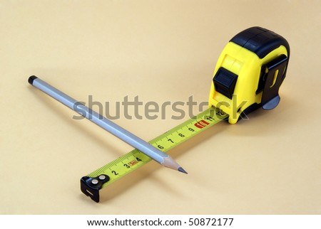 ruler and pencil on buff background - stock photo