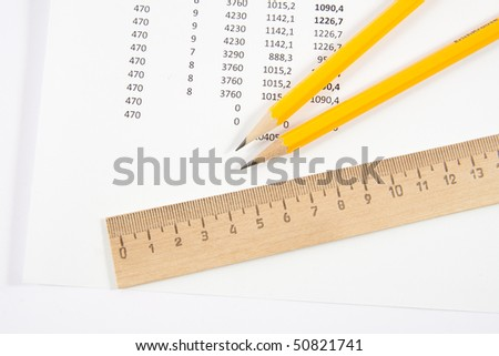 Ruler and two pencils isolated on white background