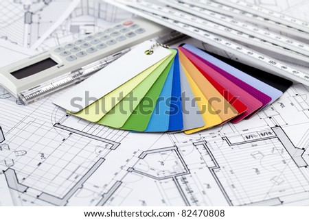 Ruler calculator, color samples of architectural materials - plastics,  metric folding ruler and architectural drawings of the modern house - stock photo
