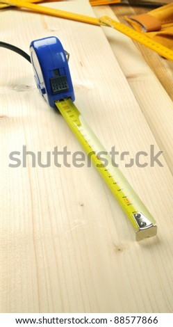 Ruler on a wooden background.