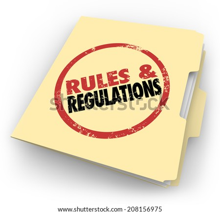 Rules and Regulations stamped on a manila folder of documents or files outlining laws or guidelines you must follow at work or in your career - stock photo