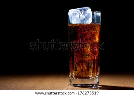 rum and cola in glass with ice