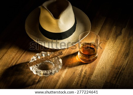 Rum, cigar an a hat