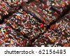Rum cuts with colorful sprinkles - traditional Czech cookies made for Christmas, wedding and other celebrations. Shallow dof - stock photo