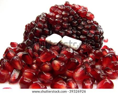 Ruminant small pillows and  pomegranate - stock photo