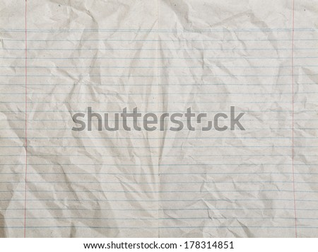 Rumpled vintage lined paper or notebook paper - stock photo