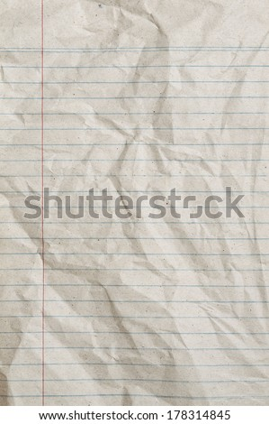 Rumpled vintage sheet of lined paper or notebook paper with left margin - stock photo