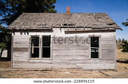 Run Down Abandoned Farm House Bleached Rotting Wood - stock photo