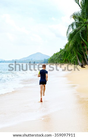 Run. Fit Athletic Man Running On Beach, Male Athlete Runner Jogging On Wet Sand During Outdoor Workout. Athletics. Sports, Fitness And Exercising. Healthy Lifestyle, Wellness And Health Concept