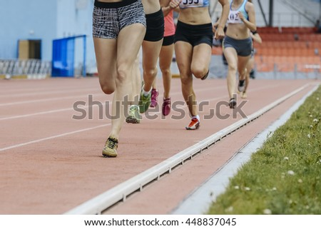run girls 800 meters at stadium during  athletics competitions
