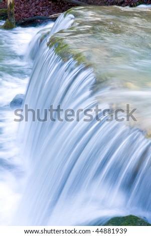 run of mountain stream on waterfall cascade - stock photo