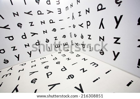 Runaround Polish letters of the alphabet on the walls - stock photo