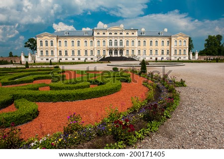 Rundale palace, former summer residence of Latvian nobility with a beautiful gardens around - stock photo