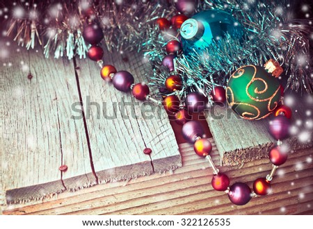 runge background/vintage paper handmade christmas decoration and snow on wooden background with copy space, pine tree branches with decoration and candy canes over wooden table