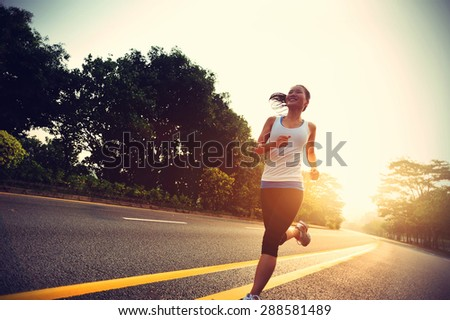 Runner athlete running at road. woman fitness sunrise jogging workout wellness concept.vintage effect