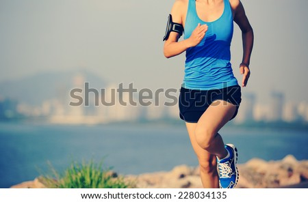 Runner athlete running at seaside city  - stock photo