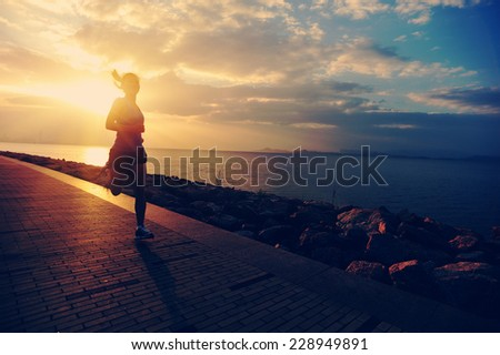 Runner athlete running at seaside. woman fitness silhouette sunrise jogging workout wellness concept.  - stock photo