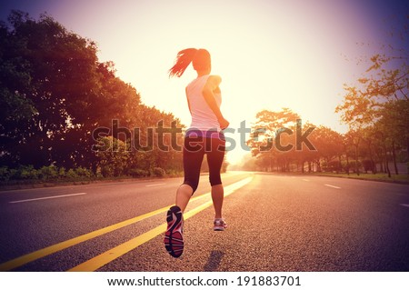 Runner athlete running on road. woman fitness sunrise jogging  workout wellness concept.  - stock photo