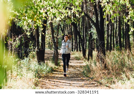 runner caucasian woman jogging in autumn park - stock photo