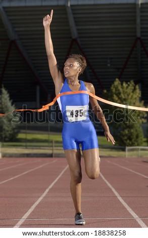 Runner crosses finish line - stock photo
