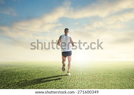 runner enjoying hard training overcoming limits - stock photo