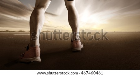 Runner feet running on road closeup on leg. Fitness sunrise jog workout wellness concept.