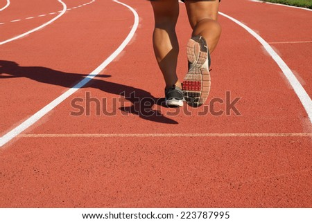Runner feet running on running track