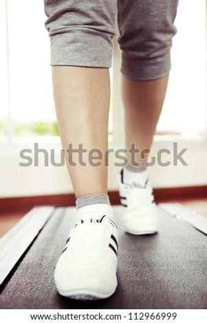 Runner feet running on running track, woman fitness - stock photo