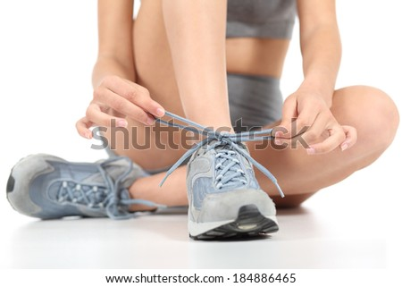 Runner fitness woman tying the shoelaces ready to sport isolated on a white background                 - stock photo