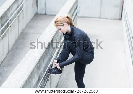 Runner has a break from physical exercises - stock photo