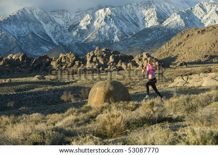 Runner in high mountains - stock photo
