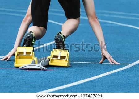 Runner is preparing for his start - stock photo