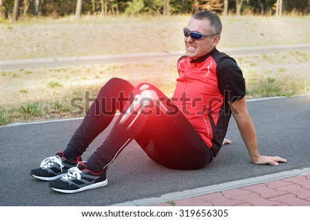 Runner knee injury and pain with leg bones visible - stock photo