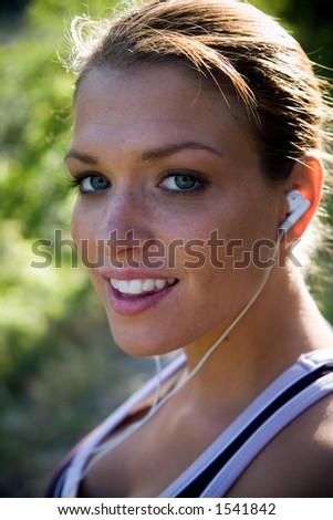 runner listening to music - stock photo