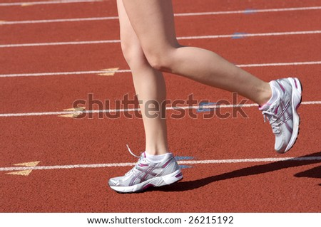 Runner on the race track practicing