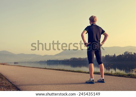 Runner on the start of distance - stock photo
