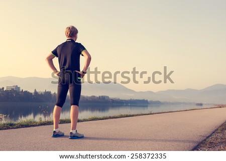 Runner on the start of distance - stock photo