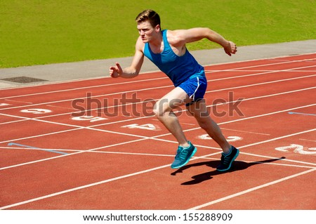 Runner on the track at a sport stadium