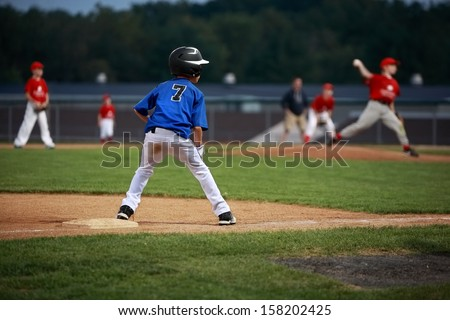 Runner on third base in a baseball game - stock photo