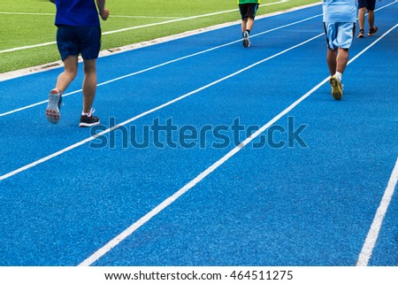Runner running in the track  blue color