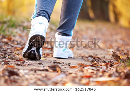 Runner running on the road. Close up running feet in trainers. Healthy lifestyle, fitness, jogging, active, young concept. - stock photo