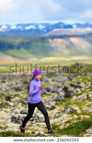 Runner. Sport running woman in cross country trail run. Female athlete exercising and training outdoors in beautiful mountain nature landscape. - stock photo