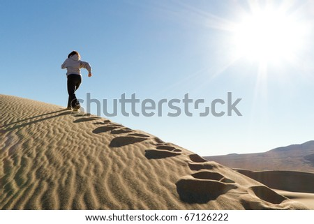 Runner Training on Dune Appreciating Nature - stock photo