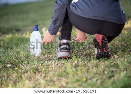 Runner trying running shoes getting ready for jogging. focus on  shoe with shoelace