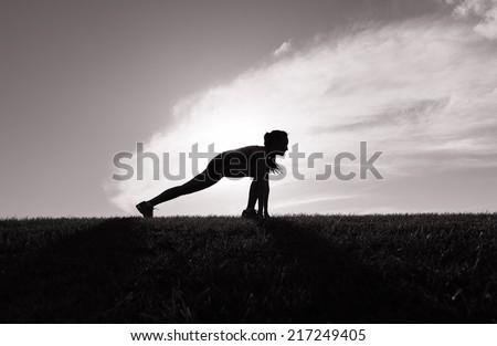 Runner woman getting ready for sunrise jog - stock photo