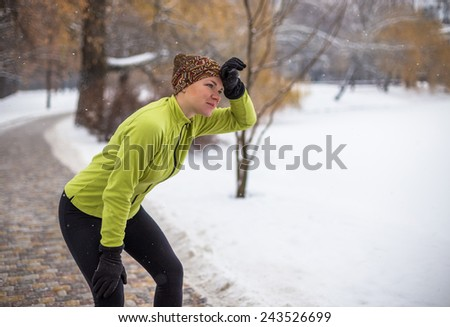 Runner woman in city park outdoor. Caucasian female sport fitness model jogging training for marathon during winter outdoor workout.  - stock photo