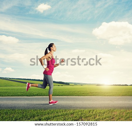 runner woman jogging in countryside - stock photo